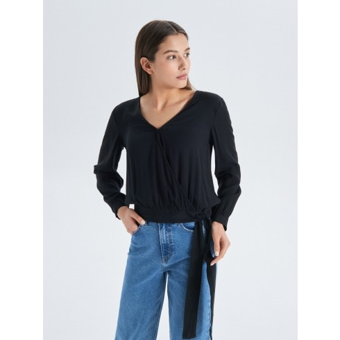 Blouse with fold-over front