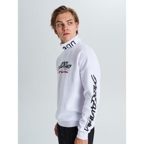A roll-neck sweatshirt